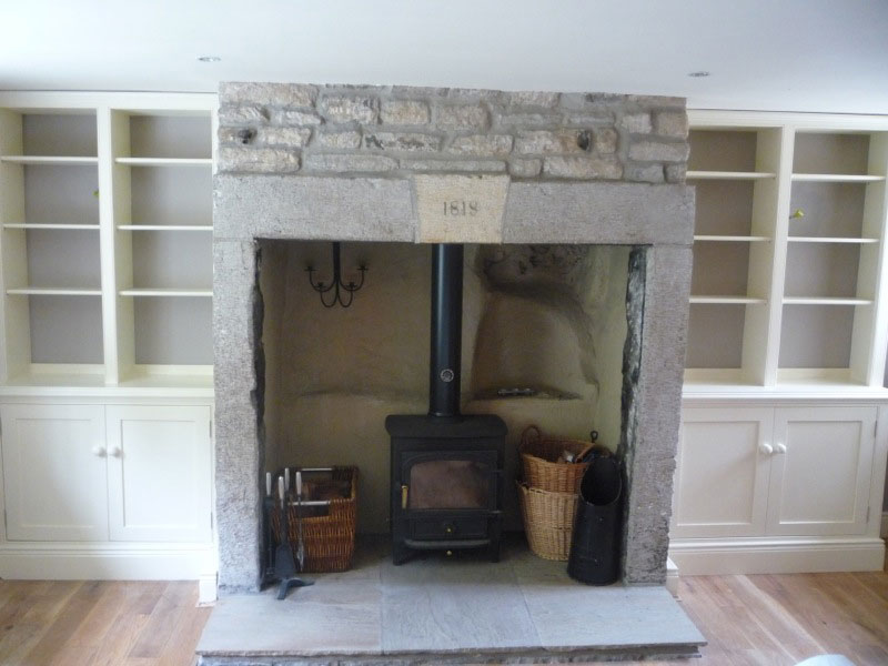 Living room with tv and fireplace - Furniture Alcoves Dunham Fitted Furniture