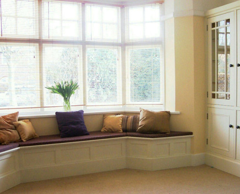 window-seat-and-glazed-alcove-cubpards
